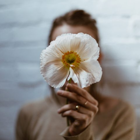 white-poppy-in-hand (1)
